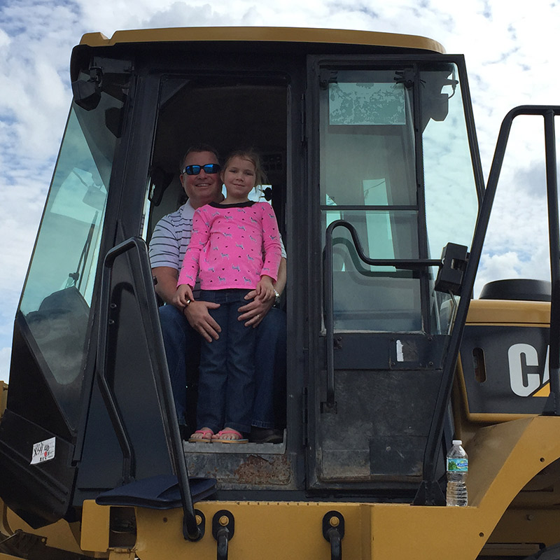 Mark Madigan and Daughter in Wheel Loader